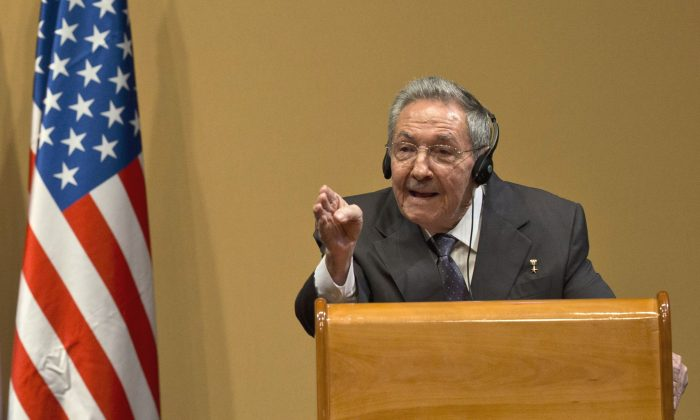 Cuba's President Raul Castro gestures as he speaks during a press conference after a joint statement with US President Barack Obama in Havana, Cuba, Monday, March 21, 2016. (AP Photo/Ramon Espinosa)