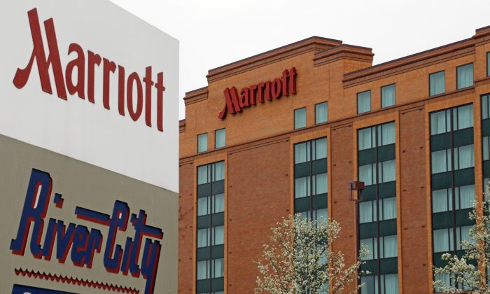 This April, 28, 2014, file photo, shows a Marriott hotel in Cranberry Township, Pa. Marriott wins over Starwood with revised buyout bid to create global hotel giant, announced Monday, March 21, 2016. (AP Photo/Gene J. Puskar, File)