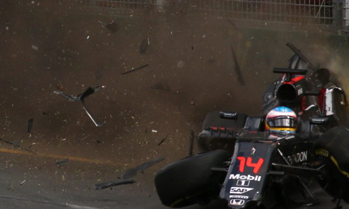 McLaren Honda's Fernando Alonso crashes into the wall after colliding with Haas F1 Team's Esteban Gutierrez during the Formula One Australian Grand Prix in Melbourne. (Max Blyton/AFP/Getty Images)