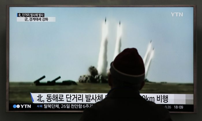 A man watches a TV screen showing a file footage of the missile launch conducted by North Korea, at Seoul Railway Station in Seoul, South Korea, Monday, March 21, 2016.  (AP Photo/Lee Jin-man)