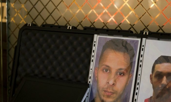A picture taken on December 3, 2015 at the Roissy-Charles-de-Gaulle airport in Roissy-en-France, outside Paris shows the wanted notice of terrorist Salah Abdeslam (L) and Mohamed Abrini. (Photo Kenzo Tribouillard/AFP/Getty Images)