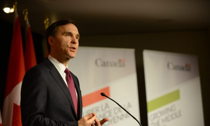 Canadian finance minister Bill Morneau speaks to reporters prior to delivering the newly elected Liberal government's first budget on March 22, 2016 in Ottawa, Canada. (Matt Little/Epoch Times)