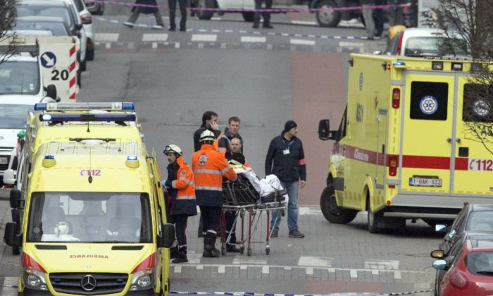 Emergency services evacuate a victim by stretcher after a explosion in a main metro station in Brussels on Tuesday, March 22, 2016. (AP Photo/Virginia Mayo)
