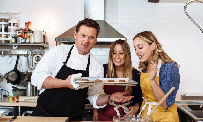 Bitty Foods' Executive Chef Tyler Florence, co-founder Leslie Ziegler, and co-founder Megan Miller savoring cookies made with cricket flour. (Michael Woolsey)