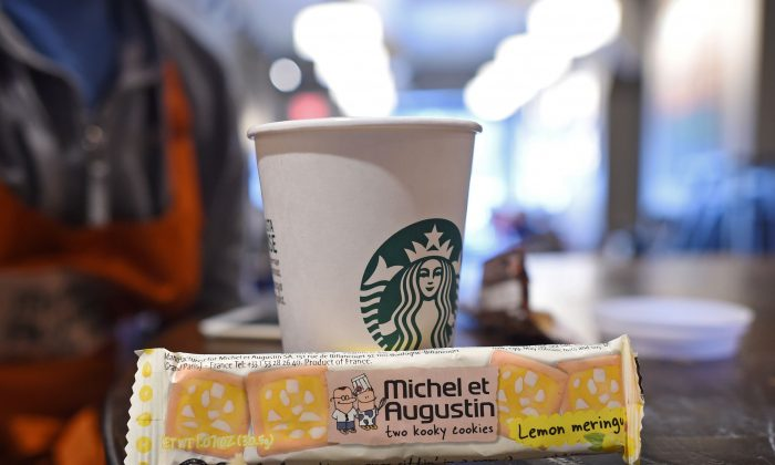 "A package of ""Michel et Augustin two kooky cookies"" sits next to a Starbucks coffee cup in a Starbucks  in Brooklyn January 6, 2016 in New York.(DON EMMERT/AFP/Getty Images)"