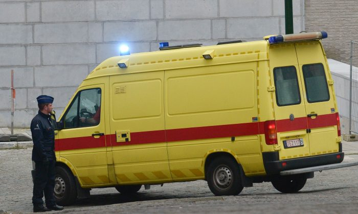 An ambulance believed to be transporting top Paris attacks suspect Salah Abdeslam leaves the building of the Federal Police in Brussels, on March 19, 2016.  (JOHN THYS/AFP/Getty Images)