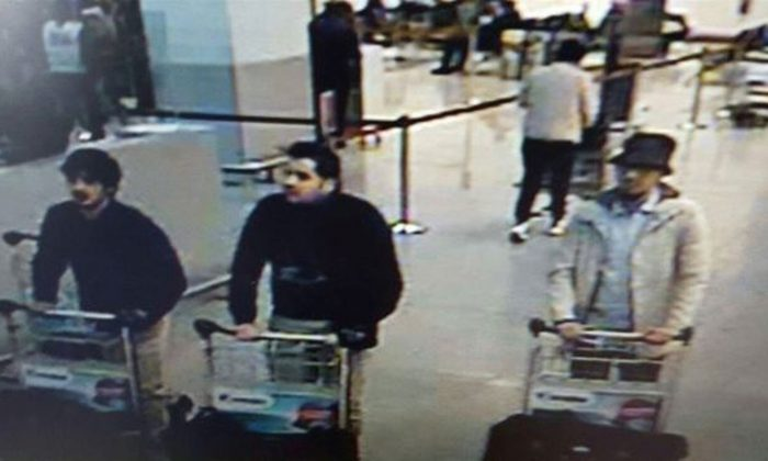 In this image provided by the Belgian Federal Police in Brussels on Tuesday, March 22, 2016, three men who are suspected of taking part in the attacks at Belgium's Zaventem Airport and are being sought by police. The men on both the left and right are yet unidentified, the man at center has been the identified by the Federal Prosecutors office on Wednesday, March 23, 2016 as Ibrahim El Bakraoui. (Belgian Federal Police via AP)