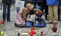 Brussels Mourns, Belgium on Alert as Police Hunt Suspect