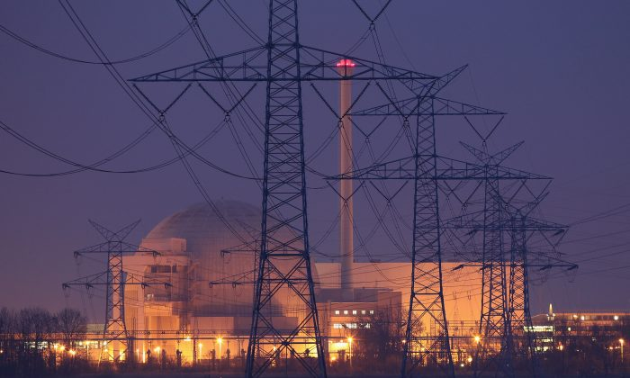 Electricity pylons stand in a row leading to the Unterweser nuclear power plant on March 21, 2011 near Stadland, Germany. The energy grid is among the critical infrastructures that experts are trying to protect from cyberattacks. (Sean Gallup/Getty Images)