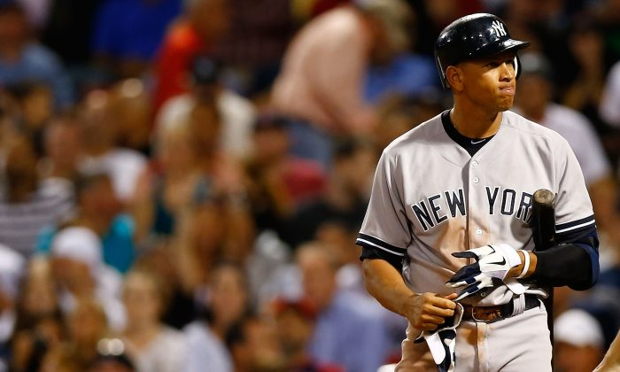 Alex Rodriguez #13 of the New York Yankees at bat against the Boston Red Sox during the game on September 13, 2012 at Fenway Park in Boston, Massachusetts.  (Photo by Jared Wickerham/Getty Images)