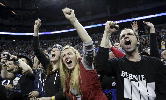 People cheer during a rally for Democratic presidential candidate Bernie Sanders at Key Arena in Seattle on March 20, 2016. (Jason Redmond/AFP/Getty Images)