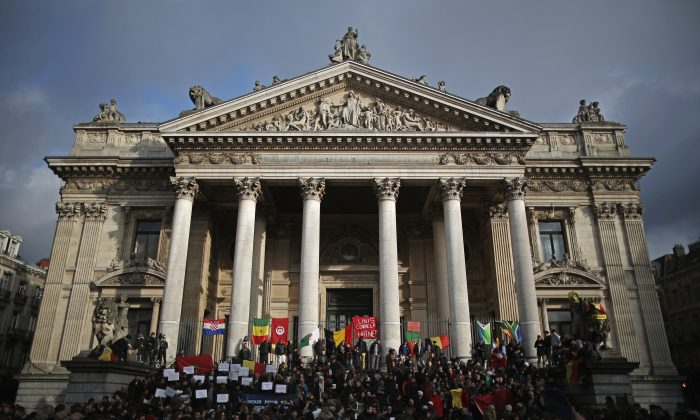 People chant and sing songs at the Place De La Bourse in honour of the victims of yesterdays' terror attacks, in Brussels, Belgium, on March 23, 2016. (Christopher Furlong/Getty Images)