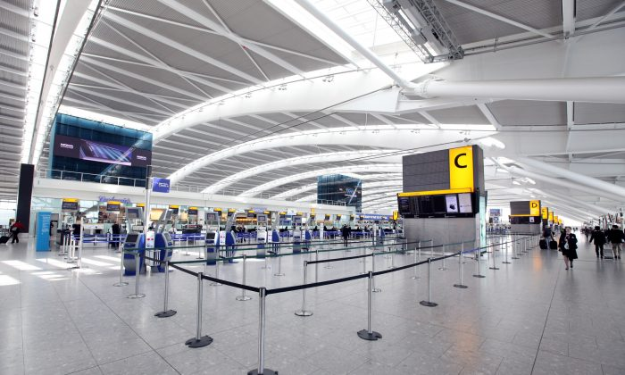 British Airways check-in desks stand empty in the departures hall of Heathrow Airport's Terminal 5 building in London, England, on April 20, 2010. (Oli Scarff/Getty Images)