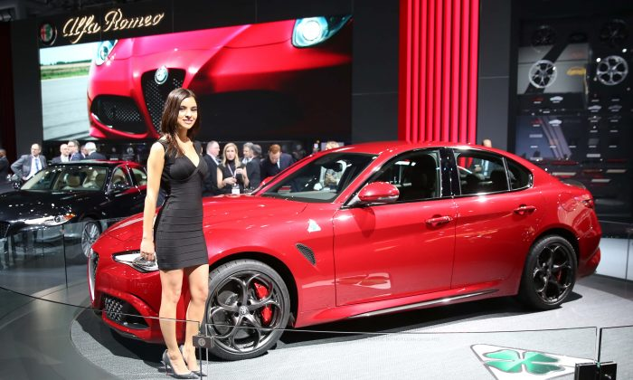 A model is next to the 2017 Alfa Romeo Giulia at the New York International Auto Show in New York on March 23, 2016. (Benjamin Chasteen/Epoch Times)