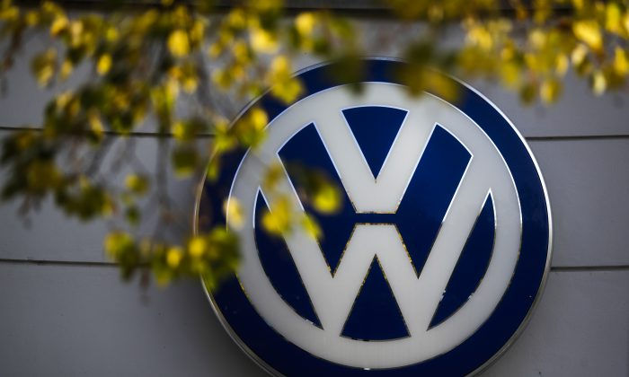 The VW sign of Germany's Volkswagen car company is displayed at the building of a company's retailer in Berlin, Germany, on Oct. 5, 2015. (AP Photo/Markus Schreiber, File)