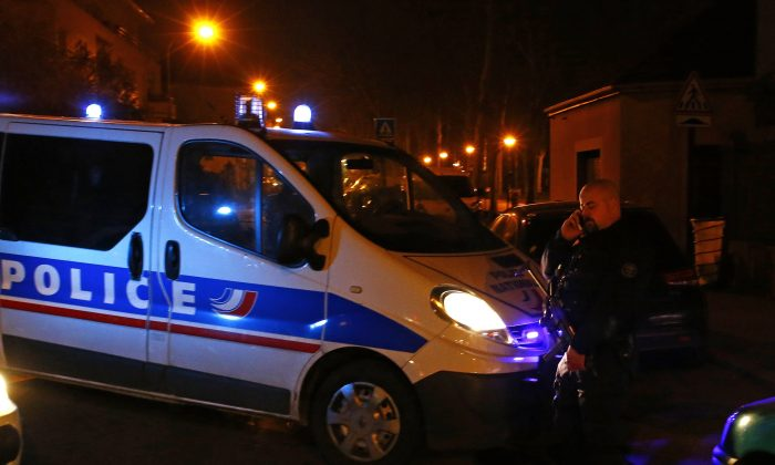 "A police officer blocks a street in Argenteuil, northwest of Paris, late Thursday March 24, 2016 as security forces locked down the area during a major search, France's interior minister said. Bernard Cazeneuve said there were no links ""at this stage"" between the plot and the attacks against Brussels this week or Paris in November. (AP Photo/Francois Mori)"