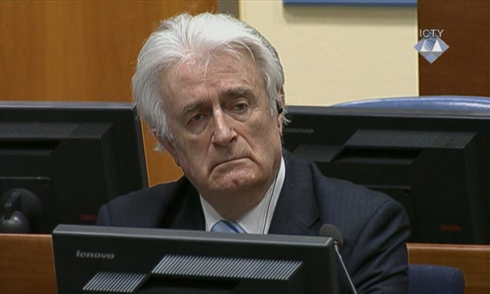 In this image taken from video Bosnian Serb wartime leader Radovan Karadzic listens to his sentence  at the International Criminal Tribunal for Former Yugoslavia (ICTY) in The Hague, The Netherlands Thursday March 24, 2016. Karadzic was convicted of genocide and nine other charges Thursday at a U.N. court, and sentenced to 40 years in prison. (ICTY, Pool via AP)
