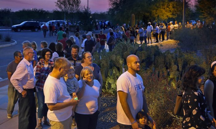 People wait in line to vote in the primary at the Environmental Education Center, Tuesday, March 22, 2016, in Chandler, Ariz. Residents in metro Phoenix have been bristling for years over a perception that state leaders want to make it harder for them to vote, and the mess at the polls Tuesday only heightened the frustration.  (David Kadlubowski/The Arizona Republic via AP)  MARICOPA COUNTY OUT; MAGS OUT; NO SALES; MANDATORY CREDIT