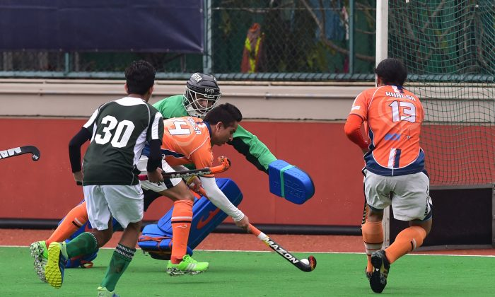 Inderpal Singh scores the first of his three goals in Khalsa's 9-0 victory over Pak-A in the HKHA premier league at HKFC on Sunday March 20.  (Bill Cox/Epoch Times)