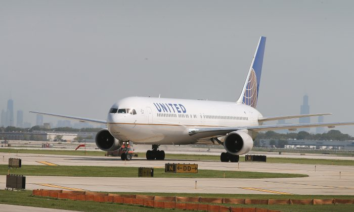CHICAGO, IL - SEPTEMBER 19: A United Airlines jet taxis at O'Hare International Airport on September 19, 2014 in Chicago, Illinois. In 2013, 67 million passengers passed through O'Hare, another 20 million passed through Chicago's Midway Airport, and the two airports combined moved more than 1.4 million tons of air cargo. (Photo by Scott Olson/Getty Images)