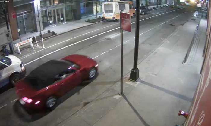 Police released surveillance video showing the red Camaro nearby the location close to the time of the incident. (NYPD)