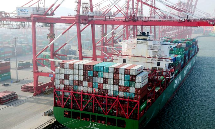 A container ship berths at the port of Qingdao in northeast China's Liaoning Province on Jan. 20, 2014. Steve Keen explains why free trade with China and Mexico hasn't worked out for U.S. workers. (STR/AFP/Getty Images)