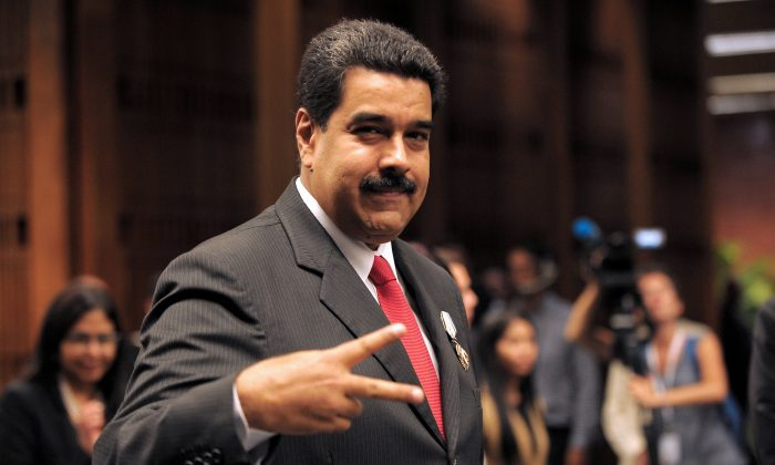Venezuelan President Nicolás Maduro gestures after receiving the Jose Marti Order at Revolution Palace in Havana, Cuba, on March 18, 2016. (Yamil Lage/AFP/Getty Images)