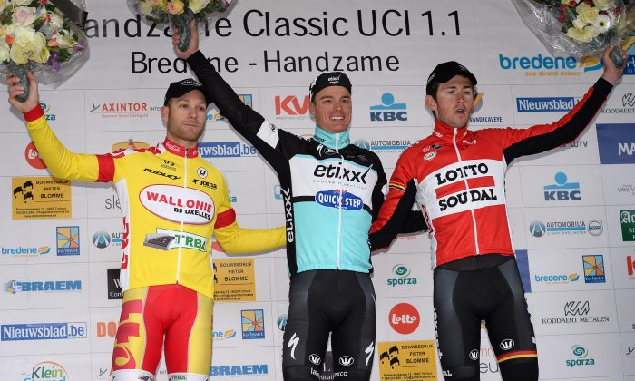 (From L) Belgian Antoine Demoitie of team Wallonie Bruxelles, Belgian Gianni Meersman of team Ettix - Quick-Step and Belgian Tiesj Benoot of Lotto - Soudal celebrate on the podium on March 20, 2015 after the 'Handzame Classic' cycling race in Handzame, Kortemark. (DAVID STOCKMAN/AFP/Getty Images)