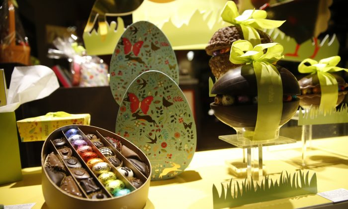 Chocolate Easter Eggs on display in a shop near the EU Commission in Brussels on March 26, 2016. While chocolatiers throughout the city are quick to offer condolences to the victims of the tragedy, they are equally fast to express concern about the future. Their livelihoods depend on people from around the globe streaming into their shops to indulge in their world famous goodies, and they know tourists don't go anywhere to be afraid. (AP Photo/Alastair Grant)