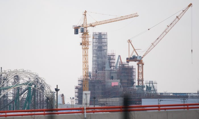 This photo taken in Shanghai on February 2, 2015, shows the castle, under construction, of the Shanghai Disney Resort's in Pudong area. (JOHANNES EISELE/AFP/Getty Images)