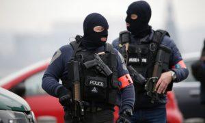 Belgium Authorities Criticized; 13 Anti-Terror Raids Made