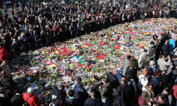 People gather in the Place de la Bourse in Brussels, Belgium, on March 27, 2016, to pay tribute to the victims of the March 22 attacks in Brussels. (Sylvain Lefevre/Getty Images)