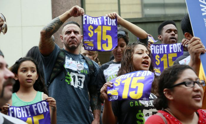Workers hold a rally in Los Angeles in support of the Los Angeles County Board of Supervisors' proposed minimum wage ordinance on July 21, 2015. On Saturday, March 26, California legislators and labor unions reached an agreement that will take the state's minimum wage from $10 to $15 an hour. (AP Photo/Nick Ut)