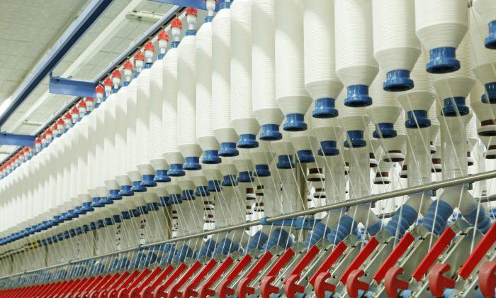 An automated spinning mill workshop. (zhengzaishuru/iStock)