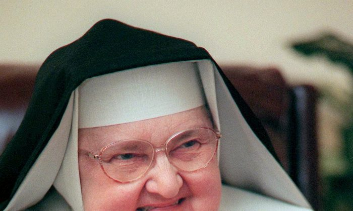 Mother Angelica, shown March 2, 1999, is both Mother Abbess of the Lady of Angels Monastery in Irondale, Ala., as well as chairman of the board or the Eternal Word Television Network.  Angelica, a folksy Roman Catholic nun who used a monastery garage to begin a television ministry that grew into a global religious media empire, had died. She was 92. (Philip Holman/Birmingham Post-Herald via AP)