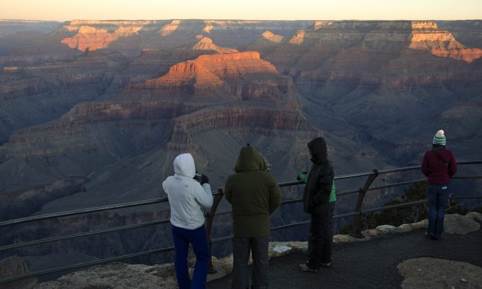 Braving wind and cold to experience sunrise at Grand Canyon on New Year's Day, Jan. 1, 2016. (M. Quinn/National Park Service, CC BY 2.0)