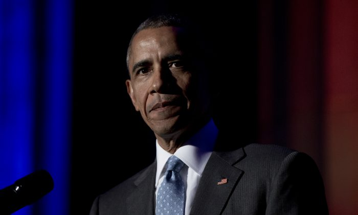 President Barack Obama pauses as he speaks during the awards dinner for Syracuse University's Toner Prize for Excellence in Political Reporting at Andrew W. Mellon Auditorium, in Washington, Monday, March 28, 2016. (AP Photo/Carolyn Kaster)