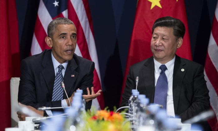 In this photo taken Nov. 30, 2015, President Barack Obama meets with Chinese President Xi Jinping in Le Bourget, France. President Barack Obama will be meeting with Asian leaders in Washington this week as fears grow that long-smoldering tensions on the Korean Peninsula and in the South China Sea could flare into conflict.  (AP Photo/Evan Vucci)