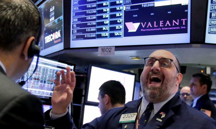 Specialist Peter Giacchi calls out prices at the post that handles Valeant Pharmaceuticals on the floor of the New York Stock Exchange, Tuesday, March 15, 2016. (AP Photo/Richard Drew)