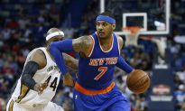 Young Fan Makes Beeline for Carmelo Anthony During Game
