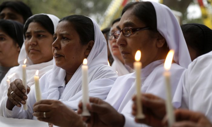 Pakistani nuns hold candles during a vigil in Lahore, Pakistan, March 28, 2016, for victims of a deadly suicide bombing. Pakistan's prime minister on Monday vowed to eliminate perpetrators of terror attacks such as the massive suicide bombing that targeted Christians gathered for Easter the previous day in the eastern city of Lahore, killing at least 70 people. (AP Photo/K.M. Chaudary)