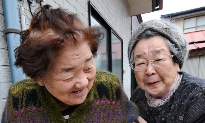 Two elderly survivors and friends smile as they are reunited 10 days after the massive 9.0 earthquake and tsunami in Ishinomaki, Miyagi Prefecture, on March 21, 2011. (Toru Yamanaka/AFP/Getty Images)