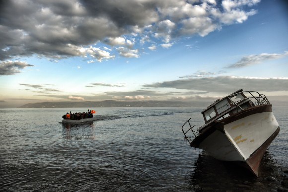 A dinghy carrying refugees and migrants crosses the Aegean Sea from Turkey to the Greek island of Lesbos on Nov. 10, 2015. (Aris Messinis/AFP/Getty Images)