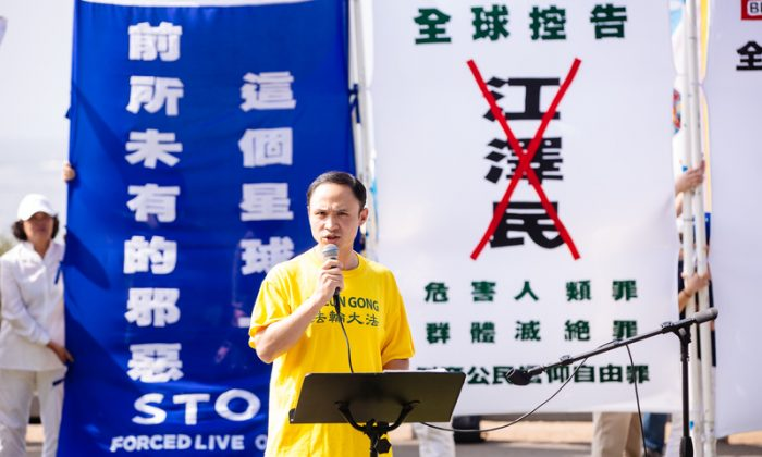 Zhang Peng speaks at a rally in Santa Monica, California, in October 2015. Zhang is a plaintiff in a recent case involving political persecution in New York. (Edward Dye/Epoch Times)