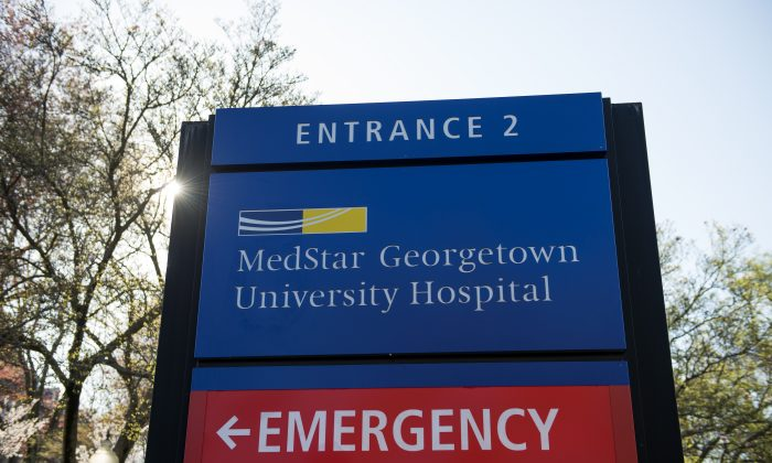 A sign designates an entrance to the MedStar Georgetown University Hospital in Washington, Monday, March 28, 2016. Hackers crippled computer systems at a major hospital chain, MedStar Health Inc., on Monday, forcing records systems offline for thousands of patients and doctors. The FBI said it was investigating whether the unknown hackers demanded a ransom to restore systems. (AP Photo/Molly Riley)