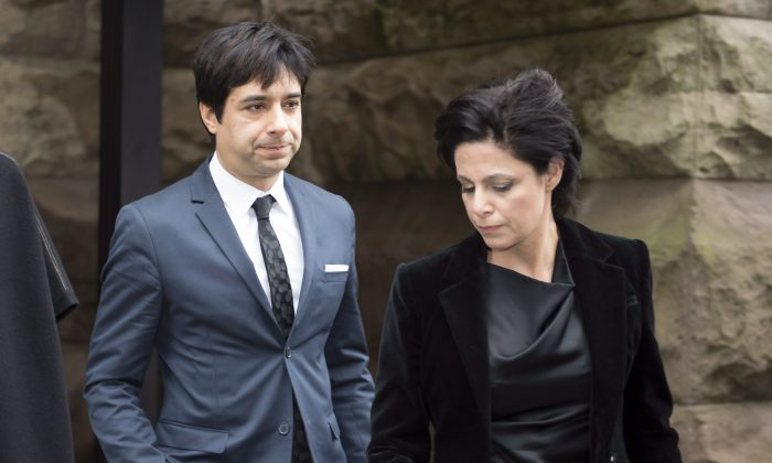 Jian Ghomeshi and his lawyer Marie Henein leave court in Toronto on March 24, 2016, after Ghomeshi was acquitted on all charges of sexual assault and choking following a trial that sparked a nationwide debate on how the justice system treats victims. (The Canadian Press/Frank Gunn)