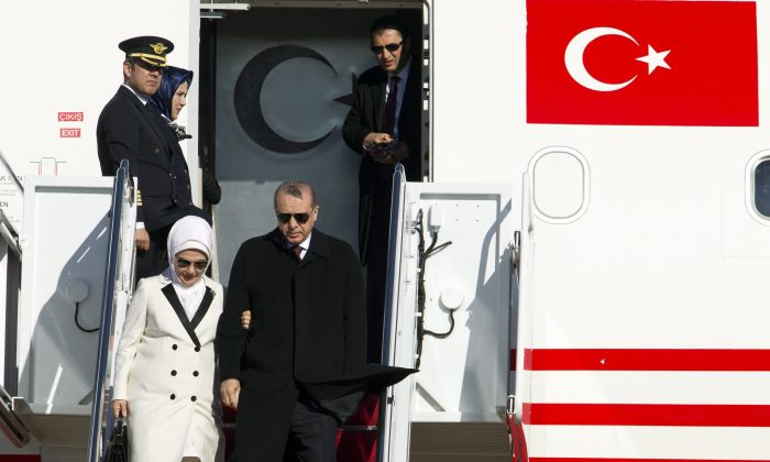 Turkish President Recep Tayyip Erdogan and his wife Emine disembark from a plane upon at Andrews Air Force Base, Md., on March 29, 2016. Erdogan is in Washington to attend the Nuclear Security Summit, along with other world leaders. (AP Photo/Jose Luis Magana)