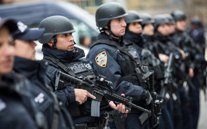 Members of the NYPD Strategic Response Group, which is funded in part through the Urban Area Security Initiative grant, stand outside NYPD headquarters in New York City on Feb. 17, 2016. (Andrew Burton/Getty Images)