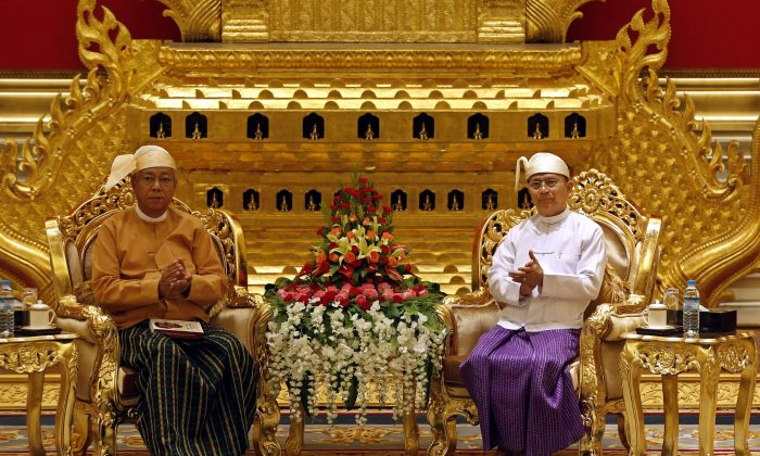 Burma's new president, academic, and long-time NLD stalwart Htin Kyaw (L) and outgoing President Thein Sein (R) during the handover ceremony at the president's house in Naypyidaw on March 30, 2016. A close aide to Aung San Suu Kyi was sworn in as Burma's president on March 30, a role that will see him act as a proxy for the pro-democracy figurehead and carry the hopes of a nation emerging from military rule. (Nyein Chan Naing/AFP/Getty Images)