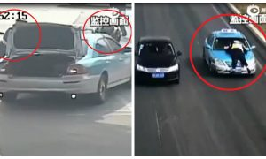 A Taxi Driver in China Speeds Away With a Police Officer on Hood